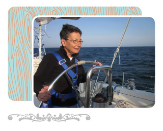 Image of author Angele Passe sailing her boat